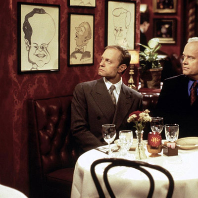 Frasier and Niles are looking at the caricature of Frasier, hanging on the wall at the Stefanos restaurant.